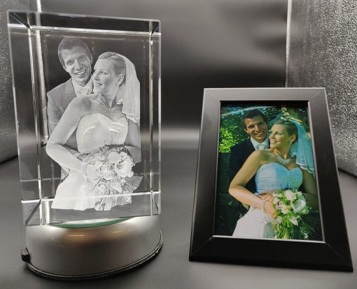 bride and groom photo engraved inside a big crystal